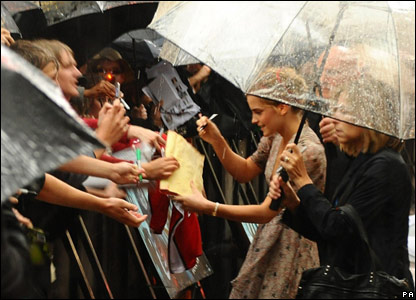 Emma Watson signing autographs for fans at the world premiere of Harry Potter and the Half-Blood Prince in London