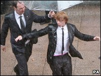 Rupert Grint dancing in the rain at the world premiere of Harry Potter and the Half-Blood Prince