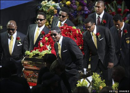 Michael Jackson's brothers carrying his coffin out of the Staples Center concert hall after his memorial service in Los Angeles