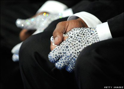 Michael Jackson's brothers each wearing a single sequined glove in honour of the King of Pop during his memorial service