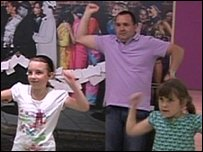 Dad and dancing kids