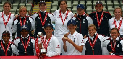 The England women's cricket team celebrate holding onto the Ashes
