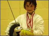 Mathew with his medals