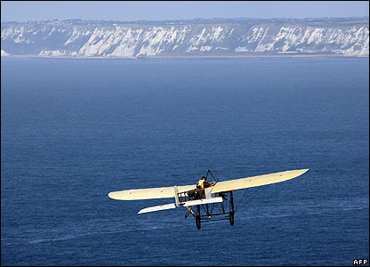 A man flies a replica of an old plane across the channel