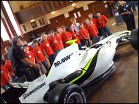 A Brawn F1 car and pupils