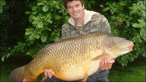 Benson the carp - being held by James Stacey