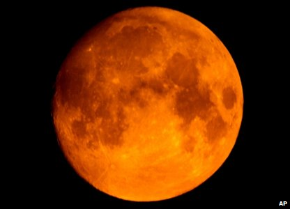 The Moon glowing orange because of the smoke from the wildfires