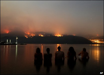 A group of friends in Lake Okanagan watching the wildfires burn on Terrace Mountain