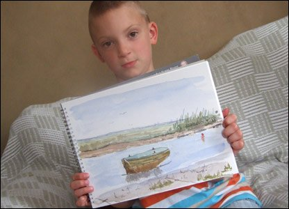Kieron with one of his watercolour paintings