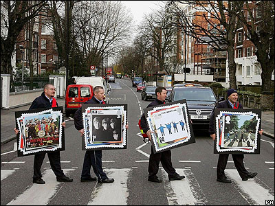 Postmen walk across Abbey Road