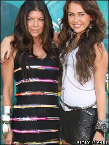Fergie from the Black Eyed Peas with Miley Cyrus at the Teen Choice Awards