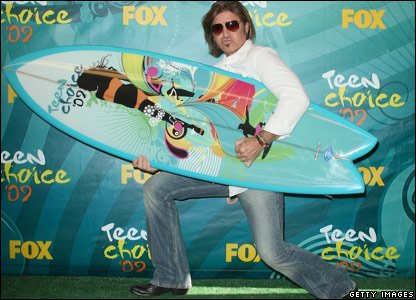Billy Ray Cyrus with his surfboard trophy