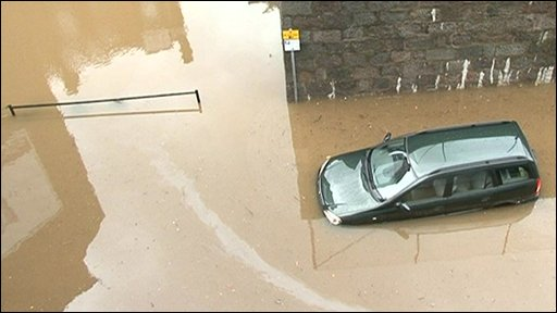A car in trouble in flood water in Scotland