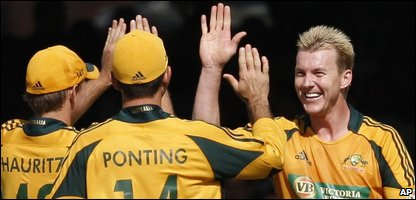 Australia's Brett Lee, right, celebrates after bowling out England's Adil Rashid