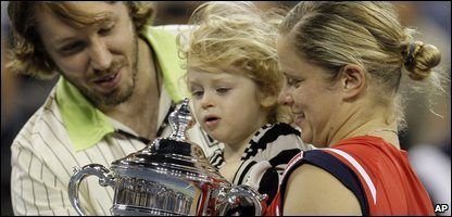US Open champion Kim Clijsters with her husband and baby celebrating her win