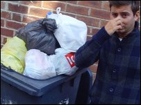 Ricky next to some of the rubbish that's piling up in Leeds
