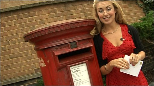 Hayley next to a post box