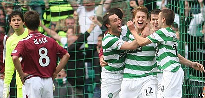 Celtic celebrate a goal against Hearts