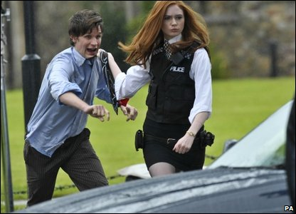 Matt Smith, the 11th Doctor Who, with his assistant Karen Gillan, dressed as a police officer