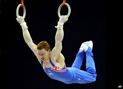 And Great Britain's Daniel Purvis shows the strength in his powerful arms on the rings.