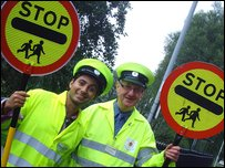 Ricky reporting for duty with lollipop man Peter