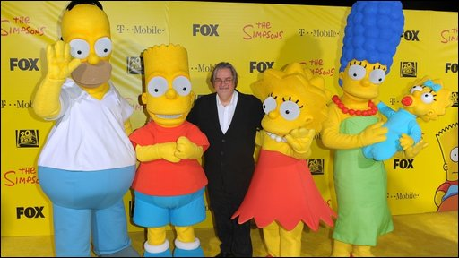 Matt Groening with his Simpsons creations
