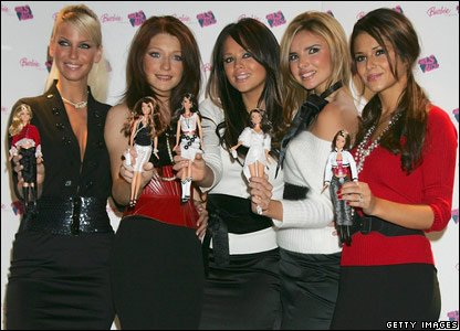 Girls Aloud with dolls of themselves