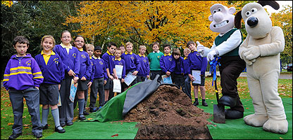 Burying the time capsule with help from Wallace and Gromit