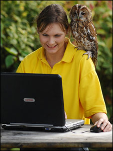 Tommy the tawny owl with Fran, who helps her with her typing. Pic provided by Totnes Rare Breeds Farm