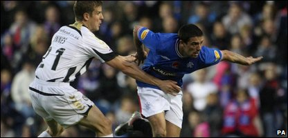 Rangers' Nacho Novo (right) and St Mirren's Chris Innes battle for the ball