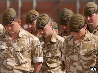 Soldiers from British and Coalition Forces taking part in a Remembrance Sunday service in Afghanistan