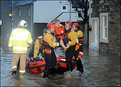 RNLI members help someone in Cockermouth