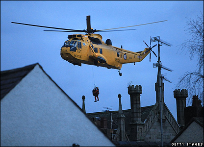 A helicopter rescues people in Cockermouth