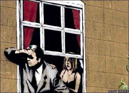 Banksy art on wall in Bristol