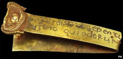 A gold strip with a Biblical inscription