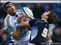 Chris Cusiter of Scotland is tackled