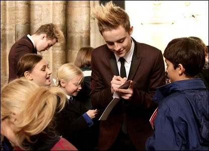 John and Edward Grimes signing autographs at the Woman's Own Children of Courage Awards in London