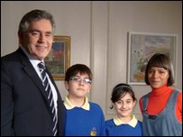 Prime Minister Gordon Brown with Leah and Press Packers Nivar and Arian