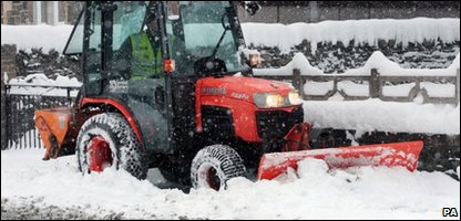 A snow plough trying to clear the snow in the Scottish borders
