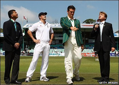 The first day of the second Test in Durban. The  captain's meet in the middle for the coin toss to decide who bats. South Africa wins - and their captain chooses to bat first.