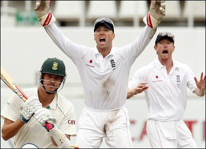 Matt Prior (centre) and Paul Collingwood (right) successfully appeal for the dismissal of Paul Harris (left)