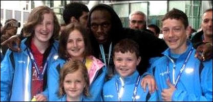 Usain Bolt with the children
