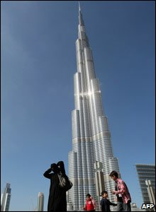 Woman takes a photo of the Burj Khalifa
