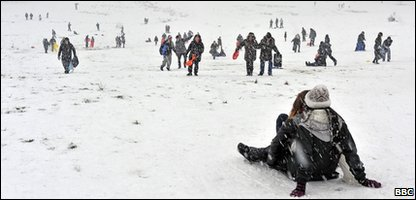 People sledging on Hampstead Heath, London