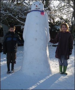 Kids and giant snowman