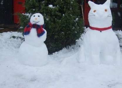 Snowman and snow cat