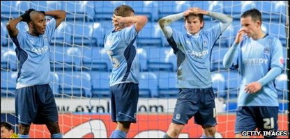 Disappointed Coventry players react after losing the match
