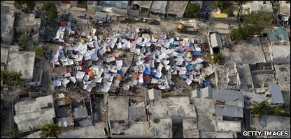 Thousands spend a second night on the streets in Port-au-Prince after the earthquake.