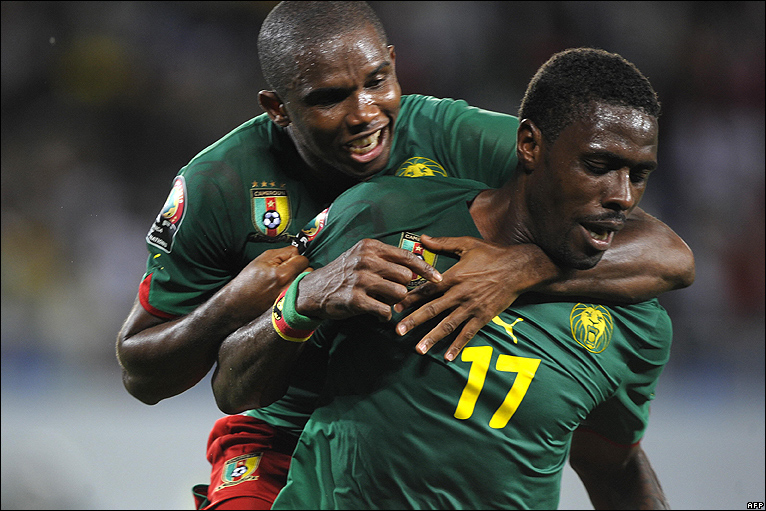 Idrissou with Samuel Eto'o on his back after scoring a goal for Cameroon; photo BBC