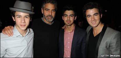 George Clooney with the Jonas Brothers before the charity telethon